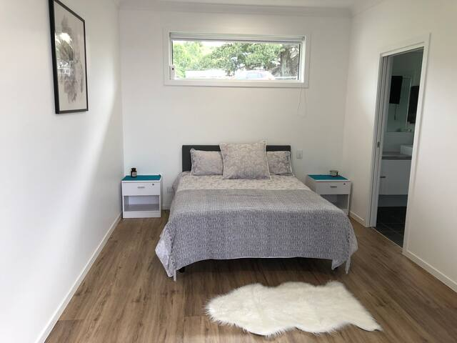 Double bed with two lockable bed side tables.