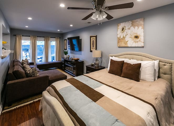 Lower level queen bedroom with sitting area and fireplace