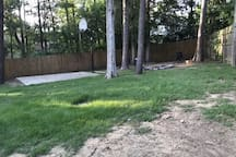 Large, fenced in back yard with wood burning fire pit and a small basketball court. Perfect for your pup!