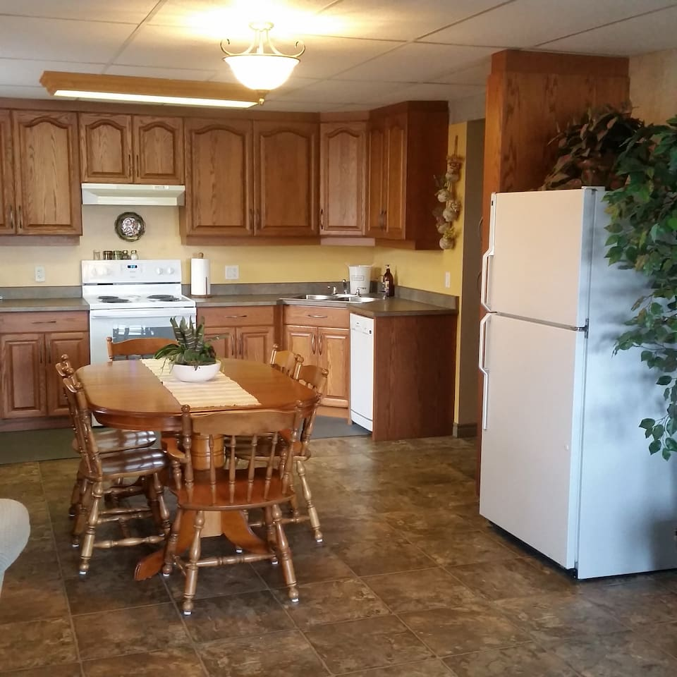 Spacious kitchen with full size stove and fridge.