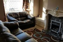 Comfortable living room with 2 and 3 seat leather sofas.