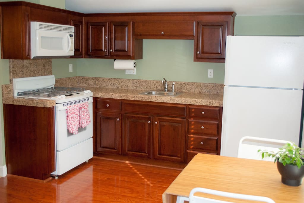 Kitchen with everything you need -- cups, plates, utensils, water filter, keurig, pots, pans