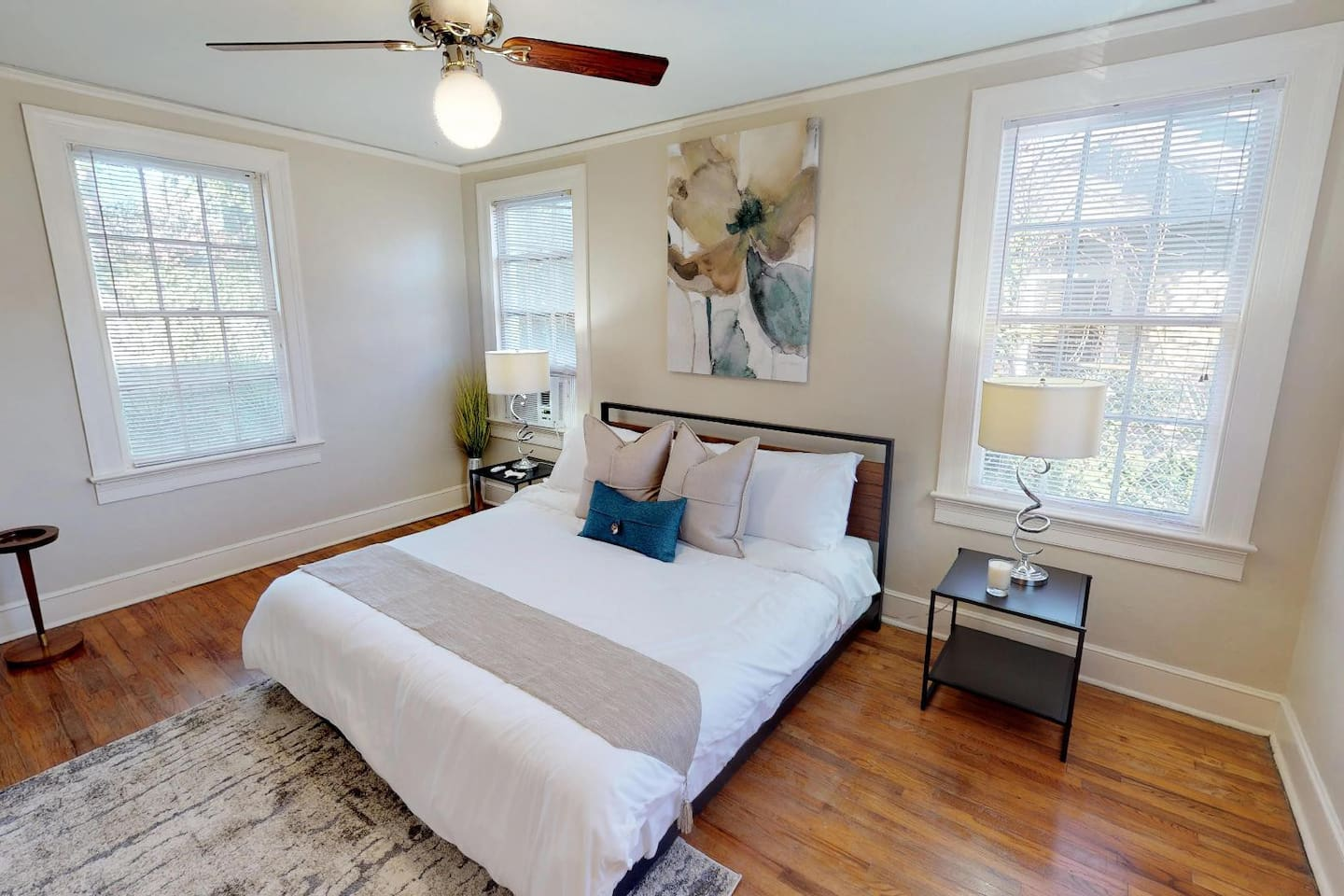 Main Bedroom with King Bed and safe-rest mattress encasement and white sheets.