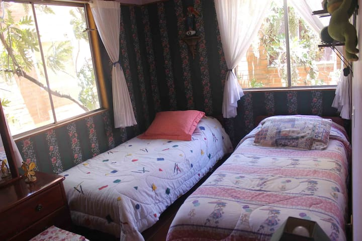 Comfy bedroom and gardens in Chia