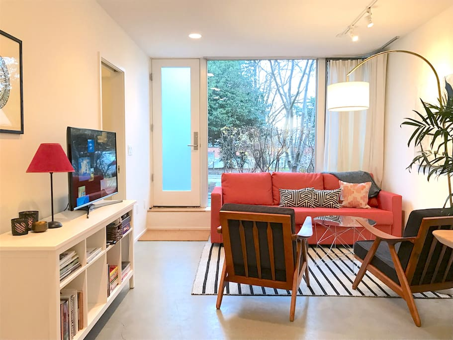 Private entrance from street leads to main room with seating, entertainment and breakfast bar.