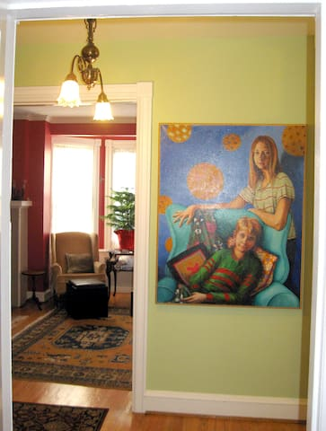 From Entry Hall to Living Room.  The portrait is of our kids, now grown.  Our Daughter is a teacher, our son in DREXEL for Architecture.