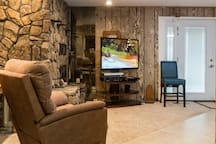 Comfortable seating in comman area living room Direct TV.