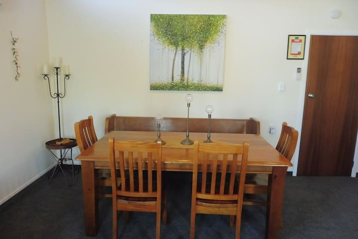 The dining room table can seat 9 with additional seating around the lounge.
