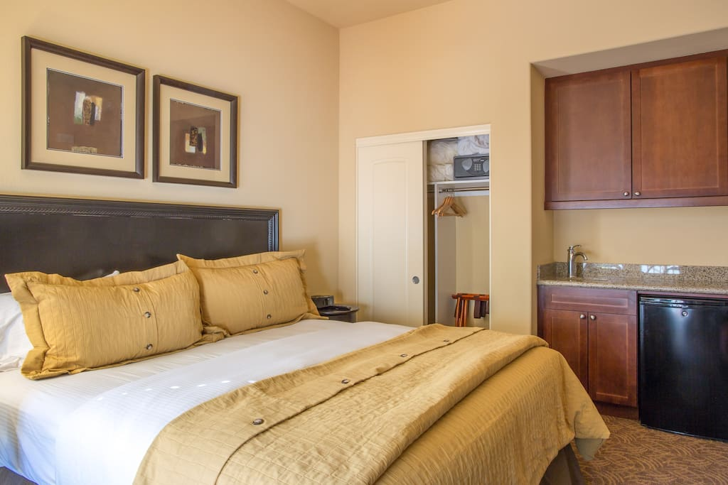 Bedroom #1- King, with kitchenette, TV, cable, fireplace, attached private full bathroom and private terrace.