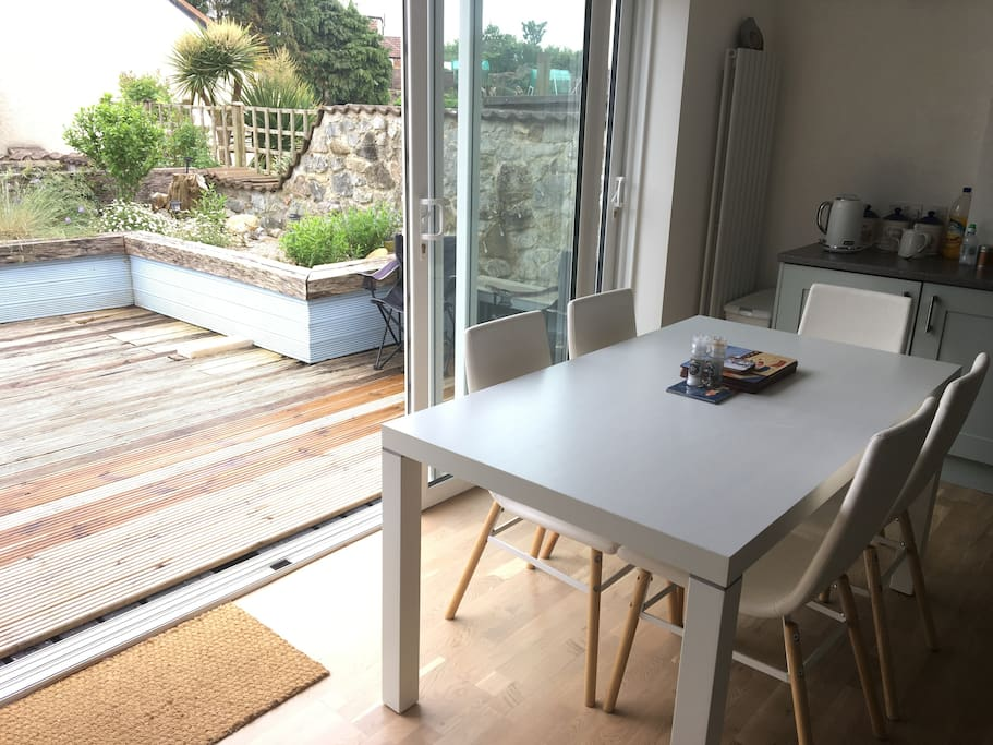 Dining area with fully opening sliding doors to garden
