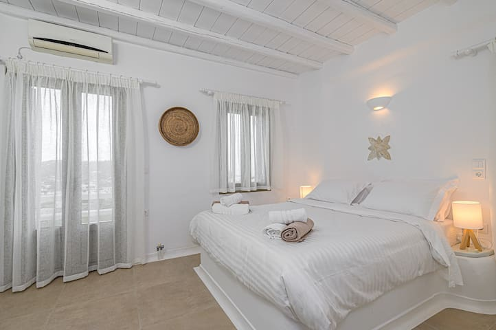 Master bedroom upstairs with private balcony and en-suite bathroom