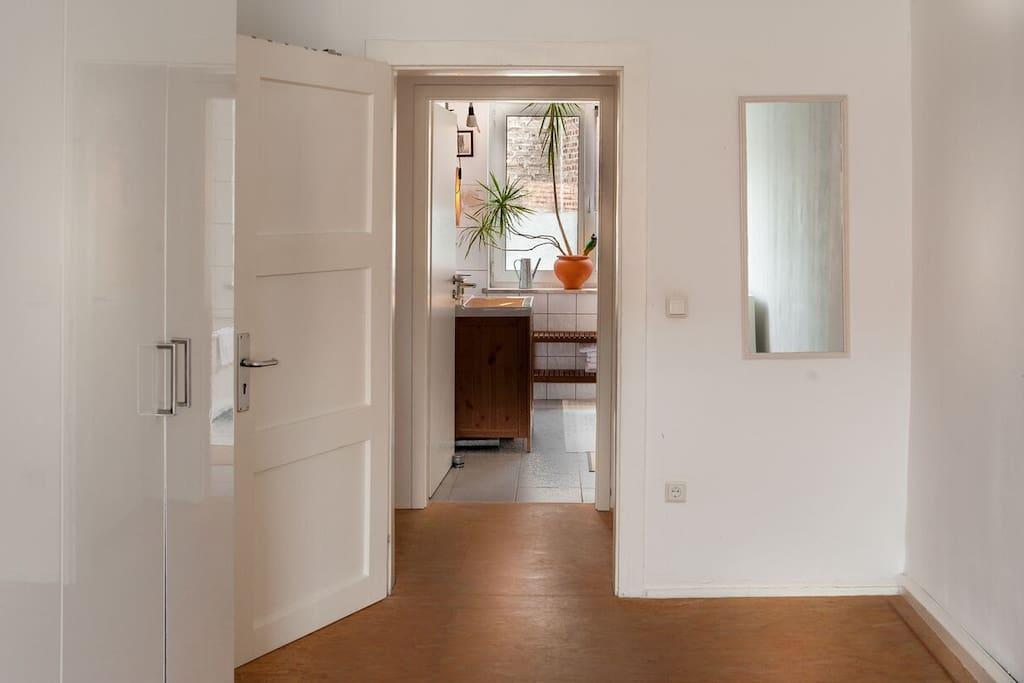 Bedroom towards bathroom across the floor