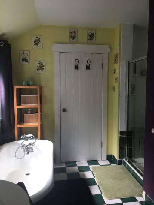 Shower cubicle & clawfoot bath
