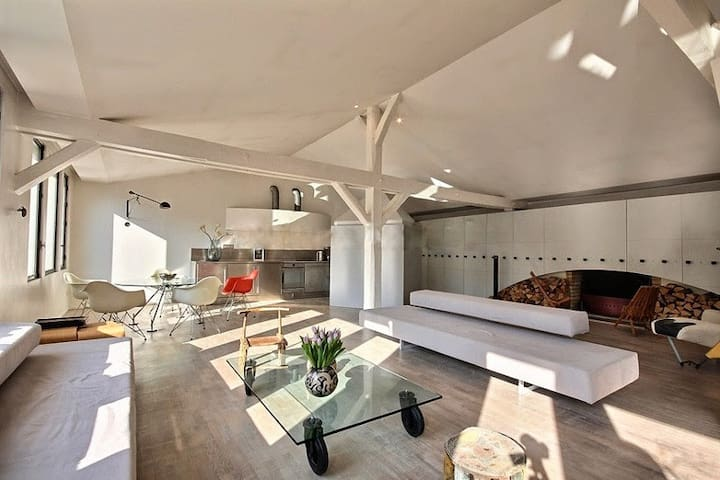 Living   The 100 square meters living room has 9 double glazed windows facing courtyard . It is equipped with : dining table for 4 people, sofa, coffee table, stereo, phone, built-in shelves, built-in wall closet, decorative fireplace.