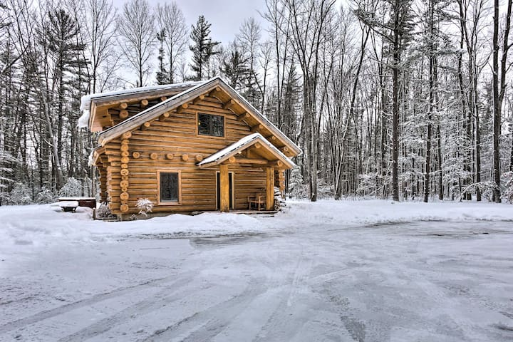 The cabin is nestled on 5 acres of land for privacy.