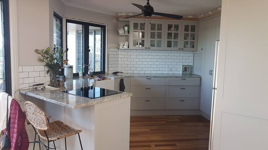 Modern kitchen granite bench tops wooden floors