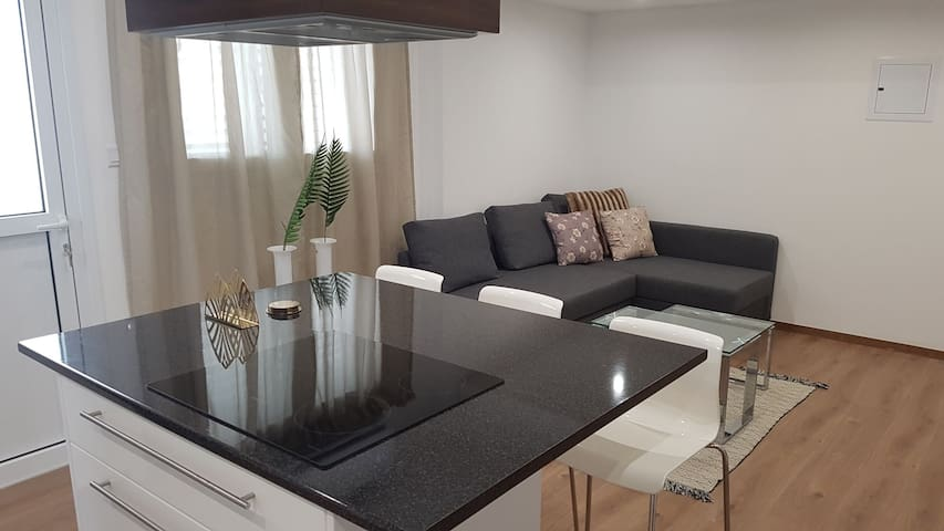 Open plan living room and kitchen with flat screen, double sofa bed and kitchen with all essentials!