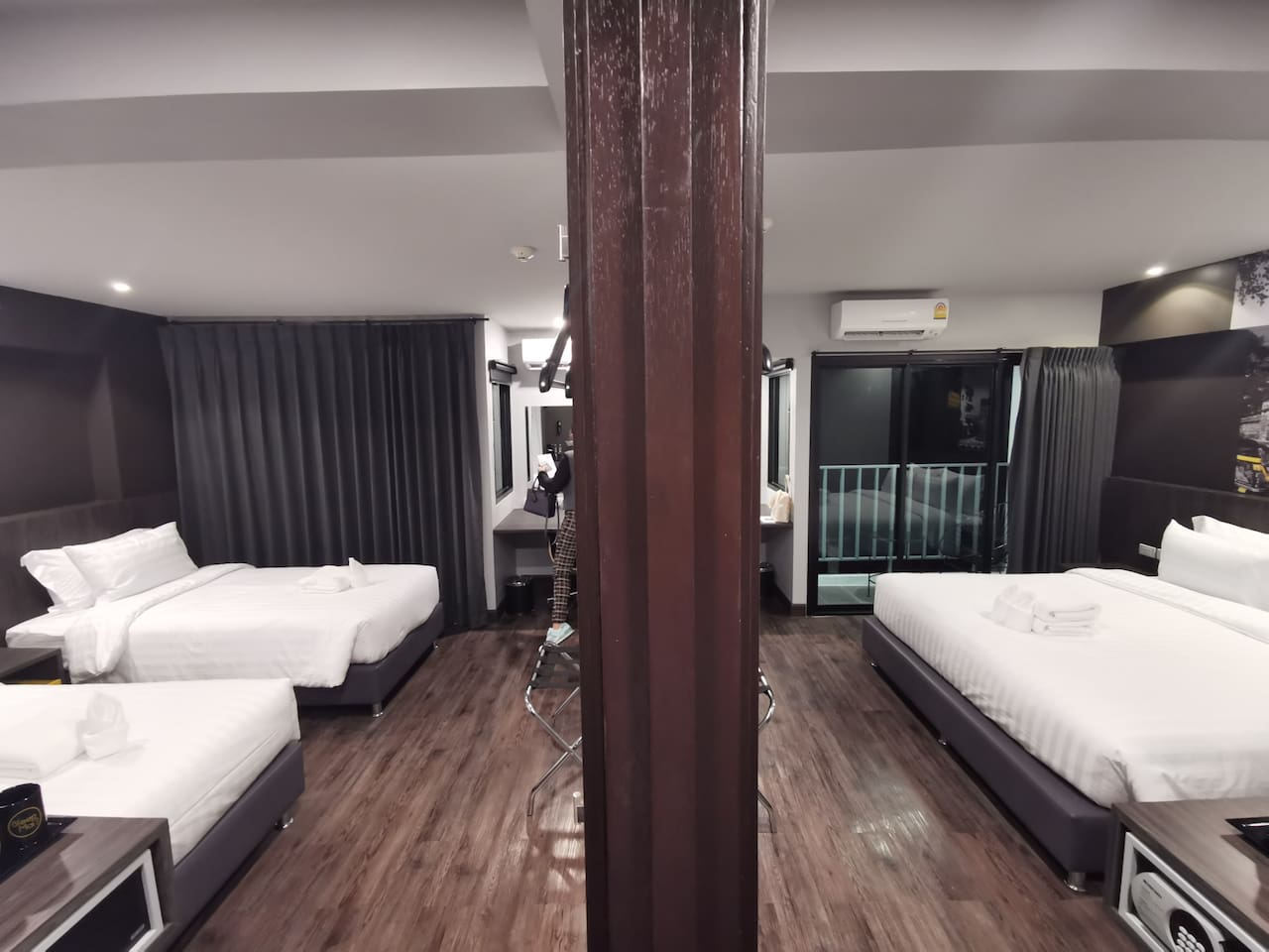 Connecting room with balcony, one bedroom is 2 single beds and another one is king size bed.