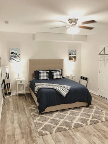"""Bedroom with queen-sized bed with 12"""" memory foam mattress"""
