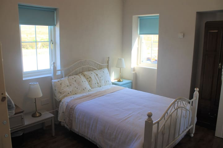 The bedroom contains a double bed and bunk bed and can comfortably sleep 4