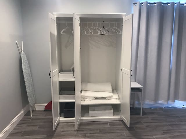 The wardrobe has plenty of space for your things, and space for a suitcase beside the wardrobe. There is also an iron for you to use