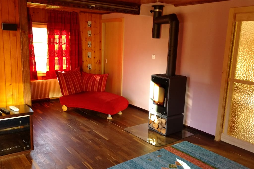 Living room with wood stove and chaise longue