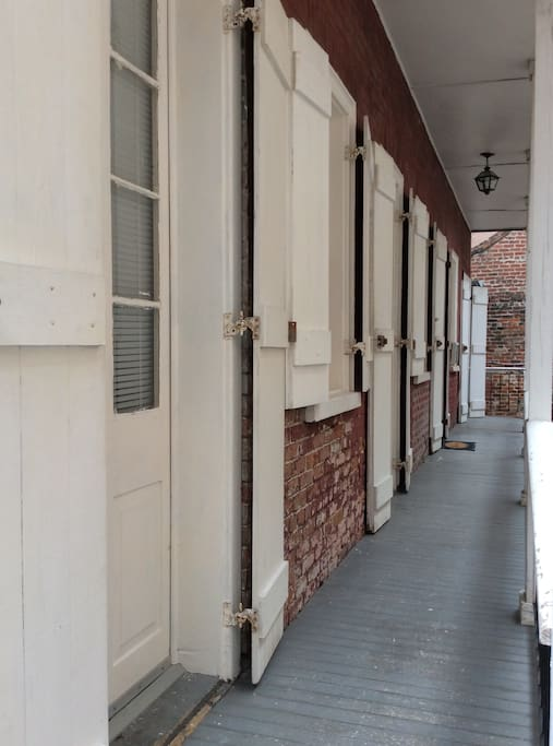 Architectural shutters on every door and window, each overlooking your private patio courtyard