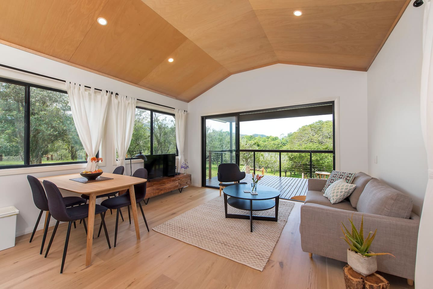 Lounge room and verandah with beautiful view over macadamia orchard
