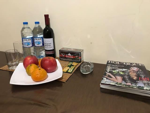national wine, water, tea, coffee in the kitchen table  национальное вино, вода, чай, кофе на кухонном столе