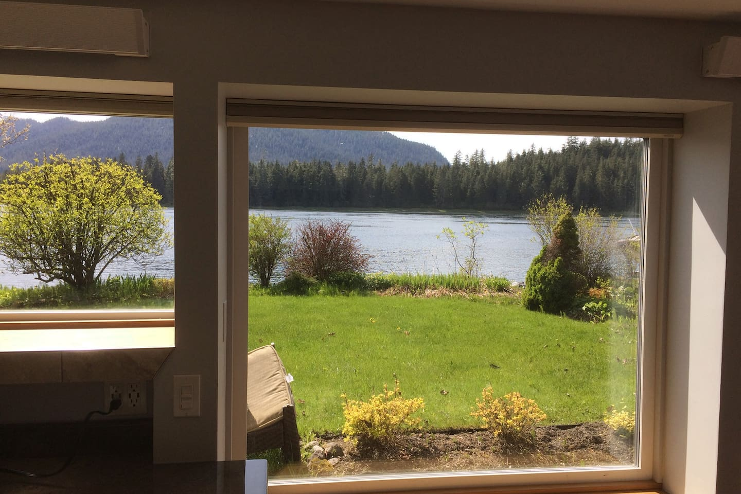 A view from the suite looking West out over the Wrangell Narrows. Beach access to explore the tidal area just beyond the yard.