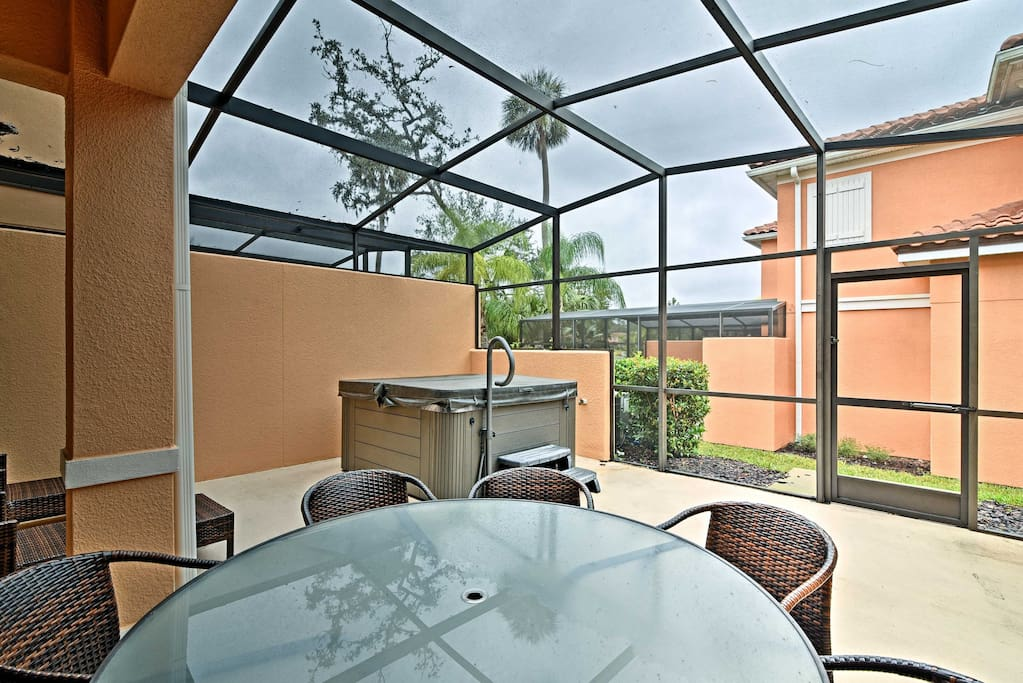 This spacious villa features a screened-in lanai with a private hot tub for optimal holiday relaxation.