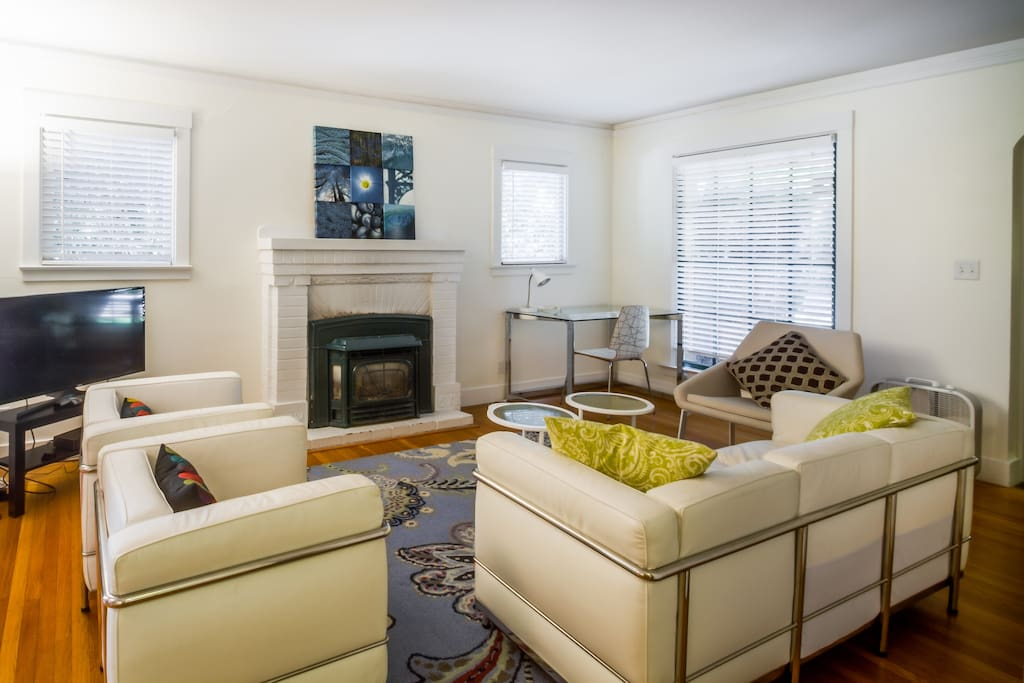 Large living room with a fireplace with insert