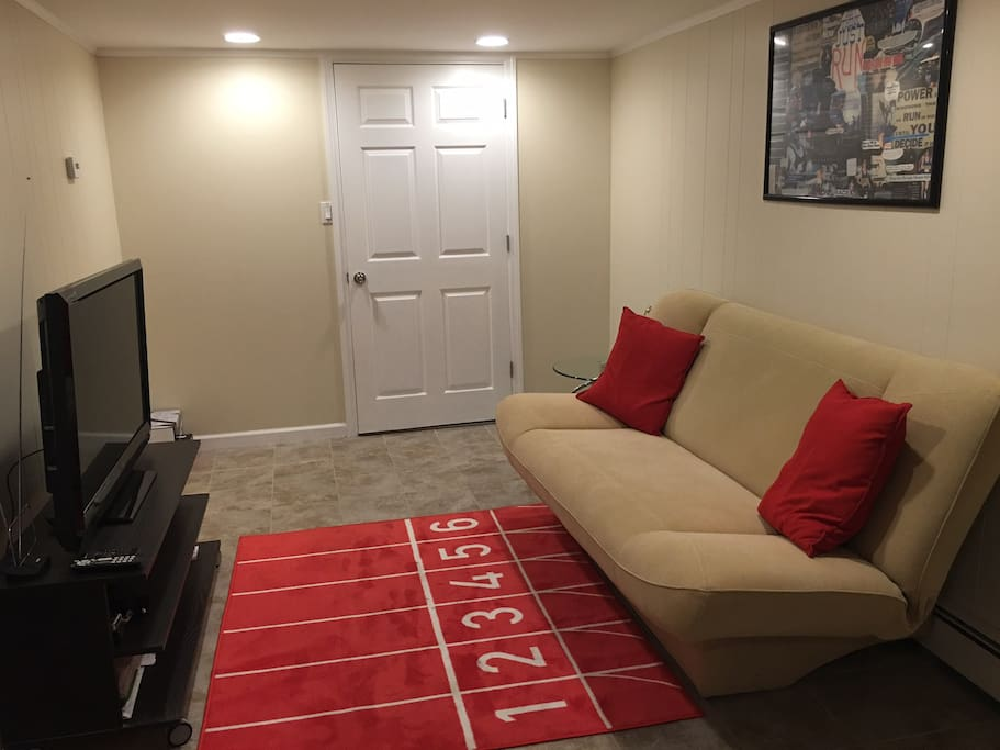 Living room with cable TV and its own private entrance