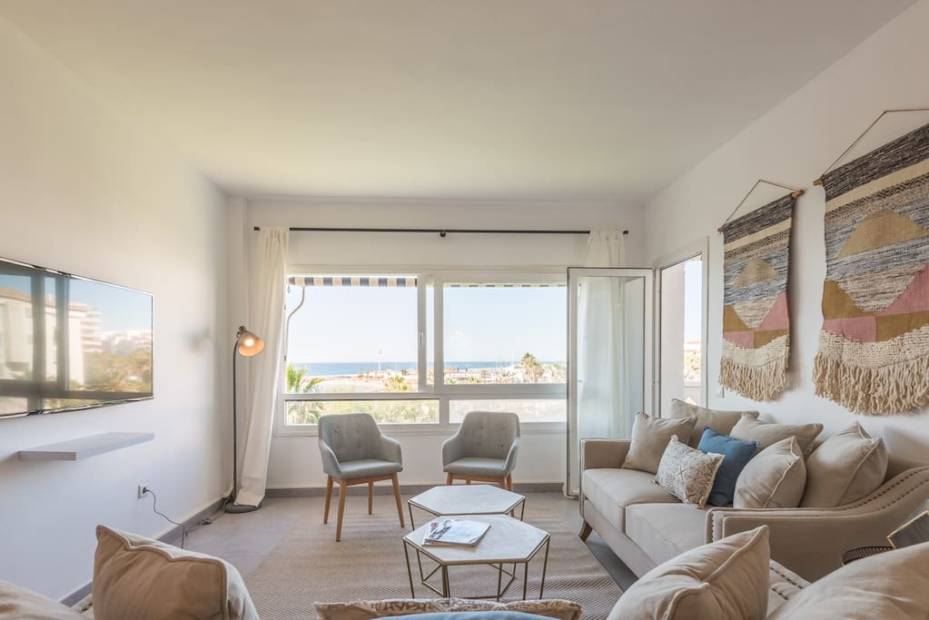 Bright and comfortable living room with a privilege seaview