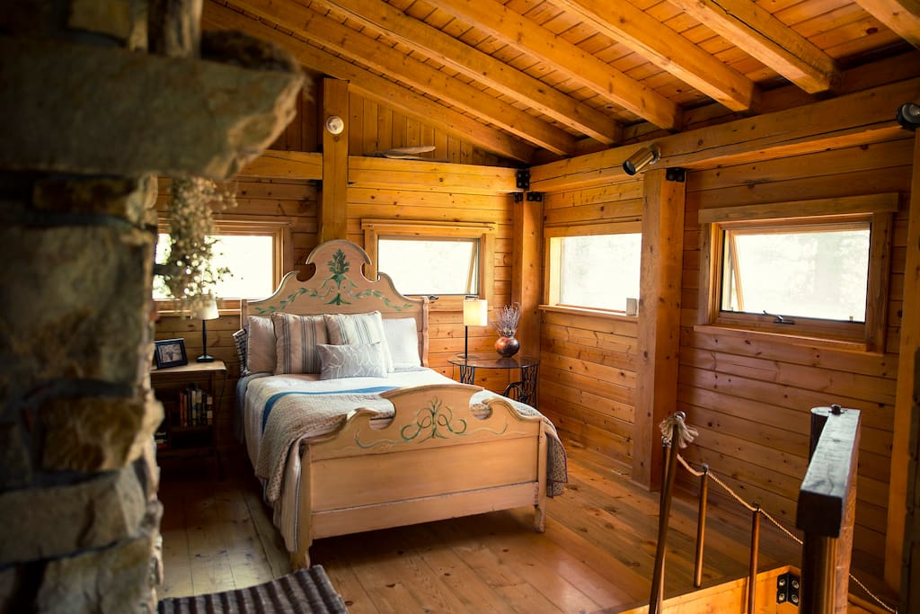 The upstairs bedroom and bathroom are an open floor design with high post&beam ceilings and lots of windows for sun-filled days and star-filled nights.