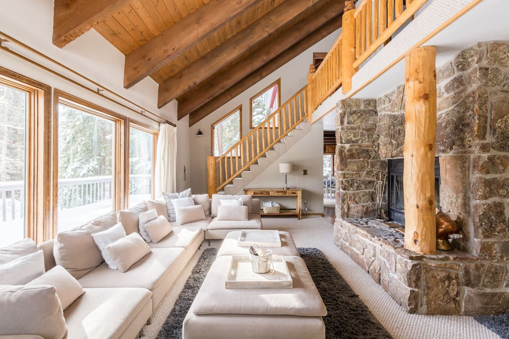Lounge in this oversized sectional next to the wood burning fireplace enjoying the mountain and tarn view.
