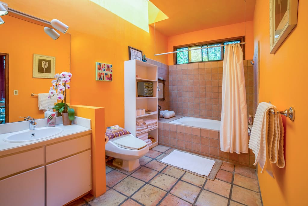 Beautiful large light and bright bathroom featuring large tub and European style shower.