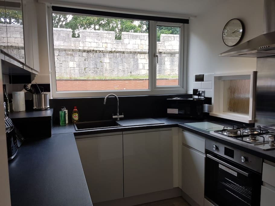 Well equipped kitchen with city wall views whilst you do the washing up! Hob, oven, grill, microwave, washing machine, fridge/freezer, kettle, toaster etc. Tea, coffee, sugar and basic condiments.