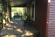 Front porch has a swing and looks onto the general store.