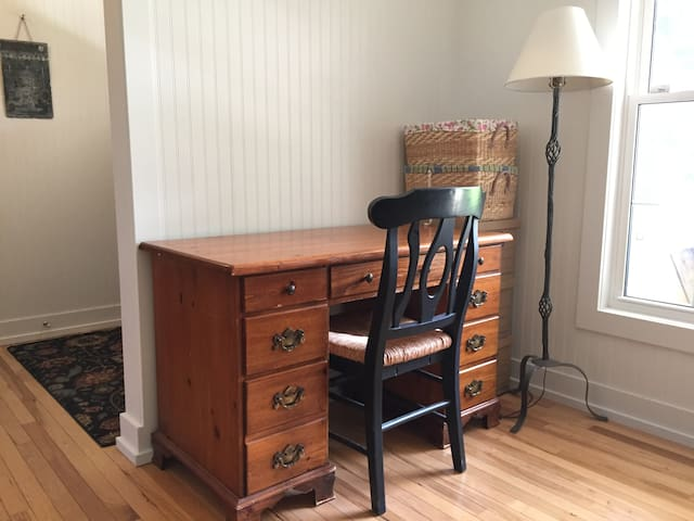 Your own desk awaits you in the shared office and art studio space.