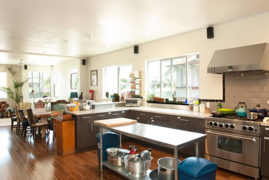 Epic Kitchen With Industrial Stove and Two Refridgerators