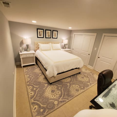 Beautiful warm and relaxing bedroom with cozy queen bed.