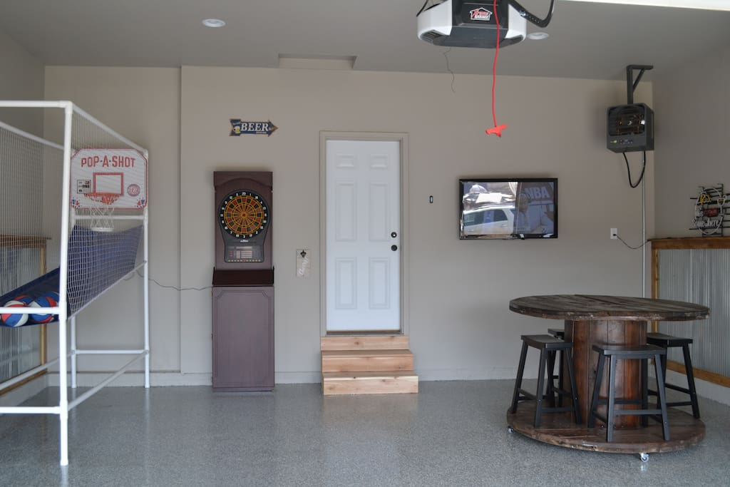 Garage Rec Room featuring electronic Pop-A-Shot, darts, ceiling speakers and TV!