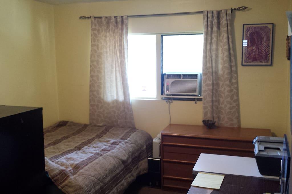 Private bedroom.  Has a dresser, AC, desk, chair, closet & wifi