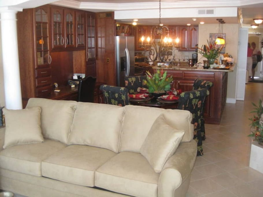 Spacious Living Room and Dining area with tile floors, cherry cabinets and desk area.