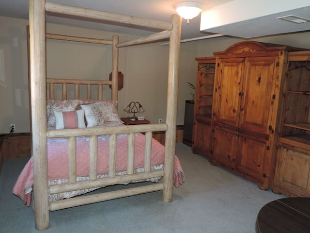 Bedroom 1 is furnished with full size memory foam mattress, wardrobe armoire, small table & chairs, cable tv, & mini fridge. Bathroom is attached.