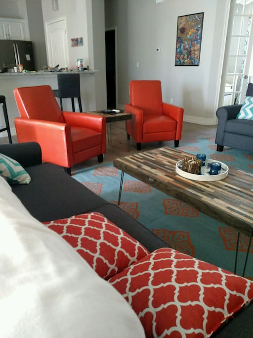 Contemporary Casual with Orange Leather Recliner Club Chairs, Wool Area Rugs Throughout
