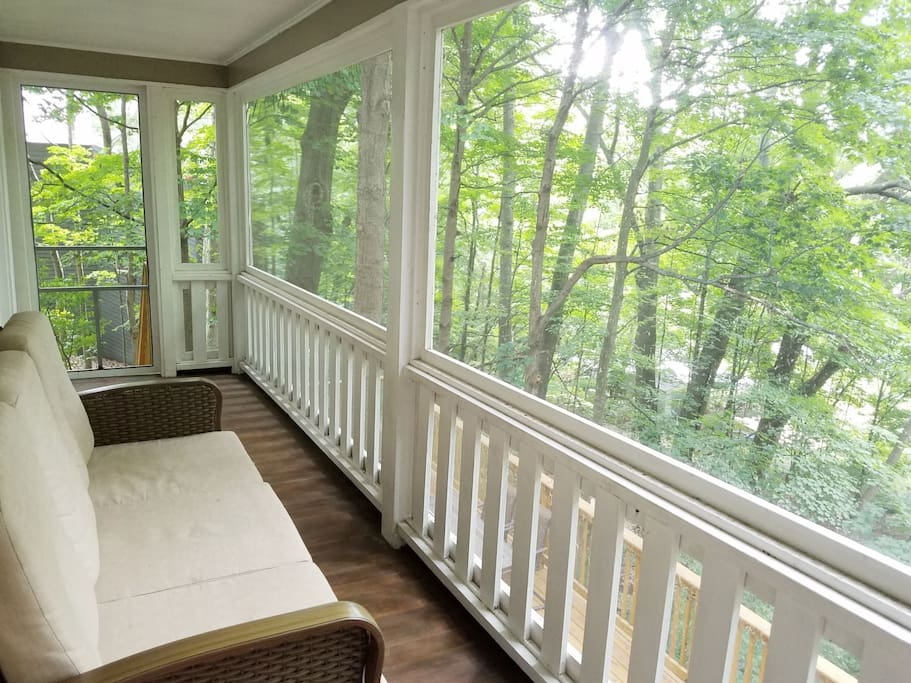 Beautiful screen porch overlooking the trees