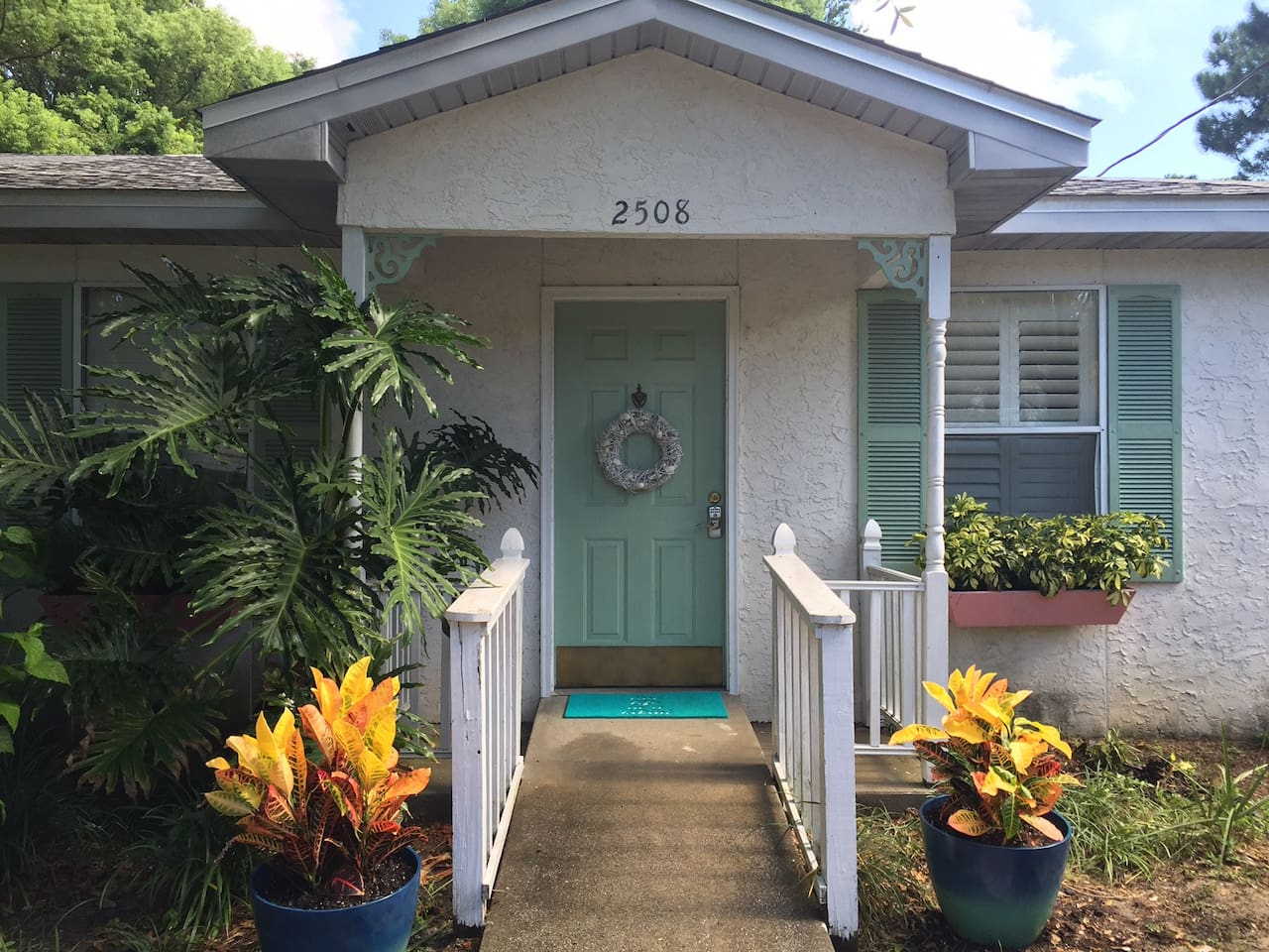 The beachy vibe starts outside when you first drive up.  Colorful plants welcome you to your home away from home!