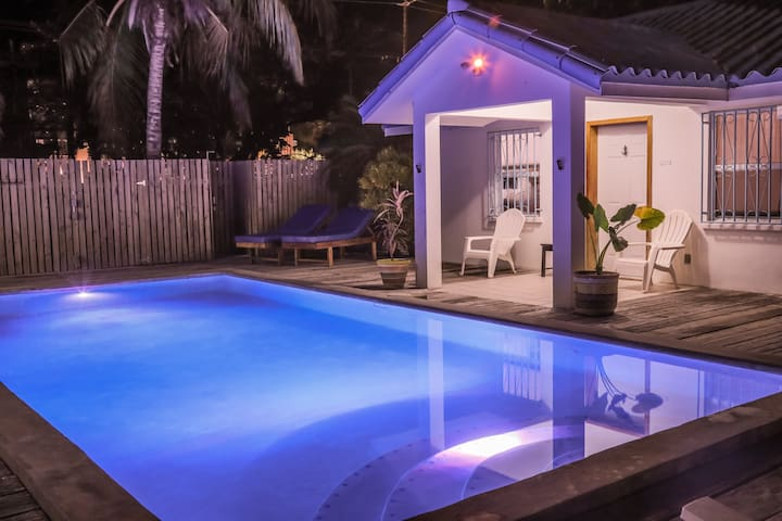 Poolside family fun, steps to the beach!